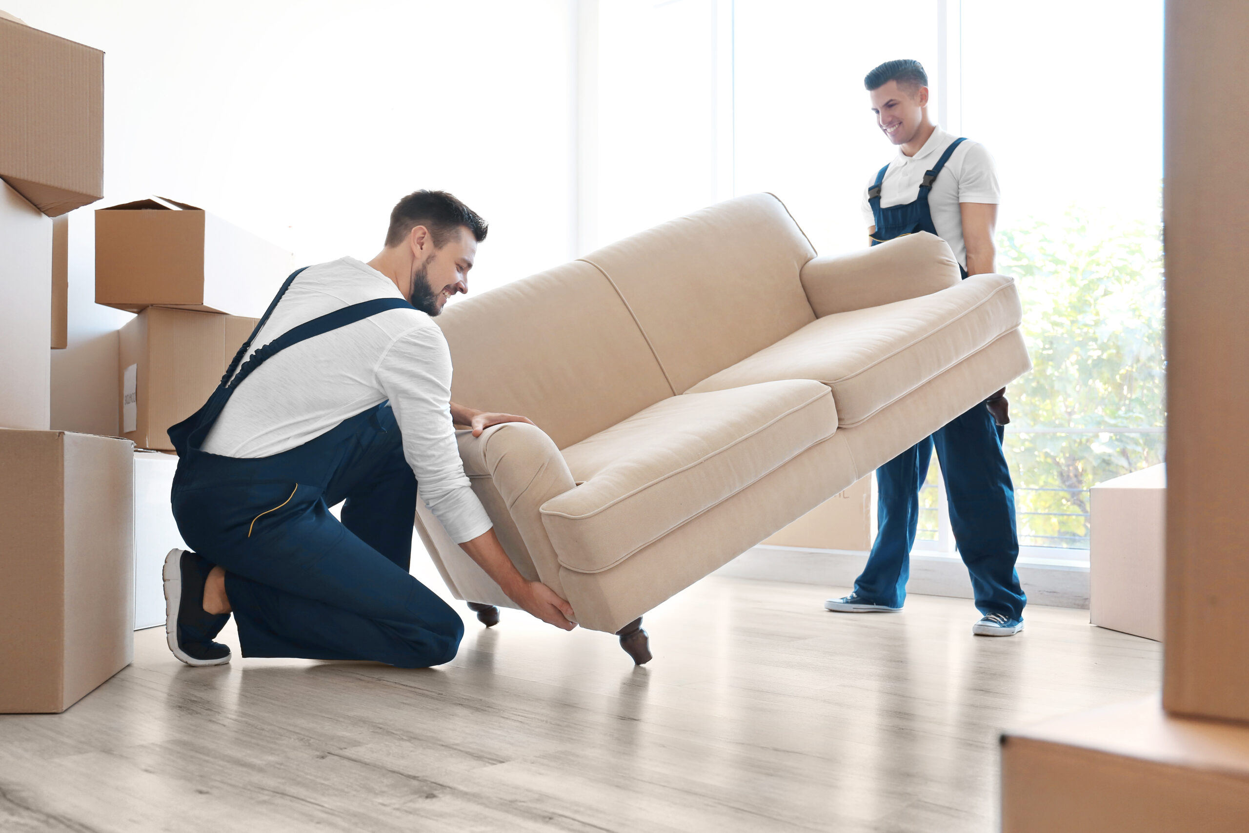 Movers moving a couch